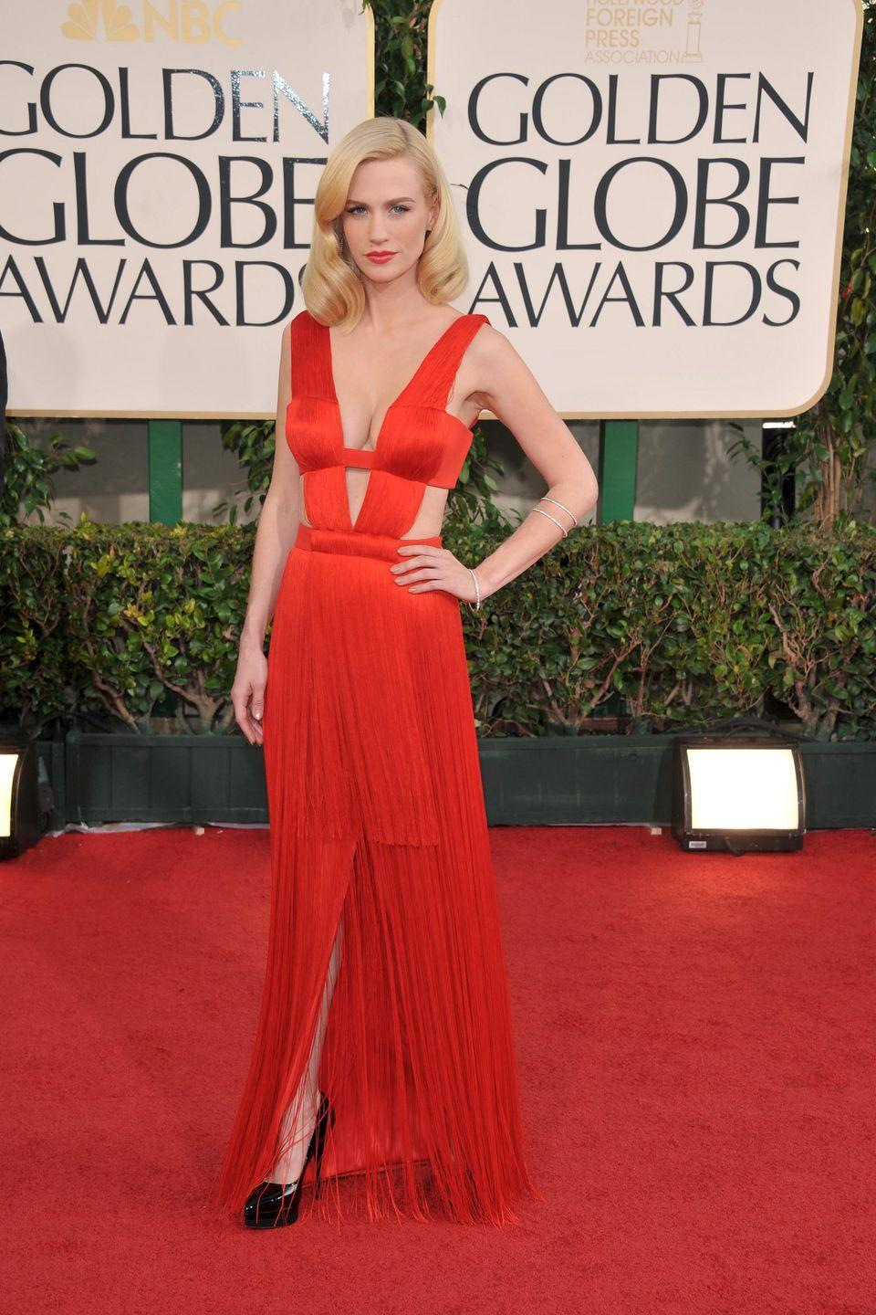 <p>It didn't get much sexier at the 2011 ceremony than the <em>Mad Men </em>star in thisAtelier Versace frock. </p>