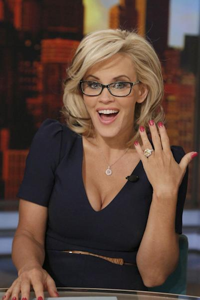 """This image released by ABC shows co-host Jenny McCarthy showing off her ring after she announced her engagement to fiance Donnie Wahlberg on the daytime series """"The View,"""" Wednesday, April 16, 2014 in New York. (AP Photo/ABC, Heidi Gutman)"""