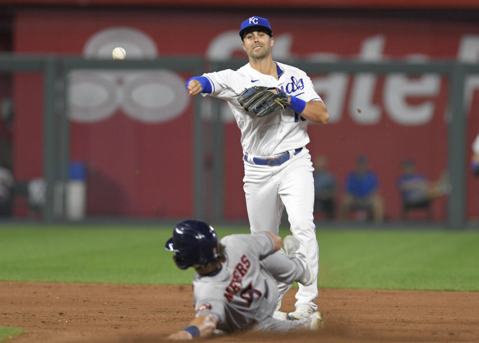Kansas City Royals' second baseman Whit Merrifield throws to first after forcing out Houston Astros' Jake Meyers, getting Martin Maldonado out for a double play during the fifth inning of a baseball game Tuesday, Aug. 17, 2021, in Kansas City, Mo. (AP Photo/Reed Hoffmann)