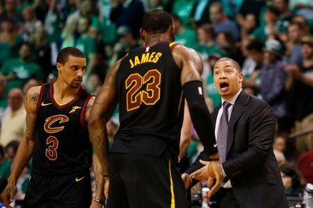 May 23, 2018; Boston, MA, USA; Cleveland Cavaliers head coach Tyronn Lue talks with forward LeBron James (23) and guard George Hill (3) during the fourth quarter against the Boston Celtics in game five of the Eastern conference finals of the 2018 NBA Playoffs at TD Garden. Mandatory Credit: Winslow Townson-USA TODAY Sports