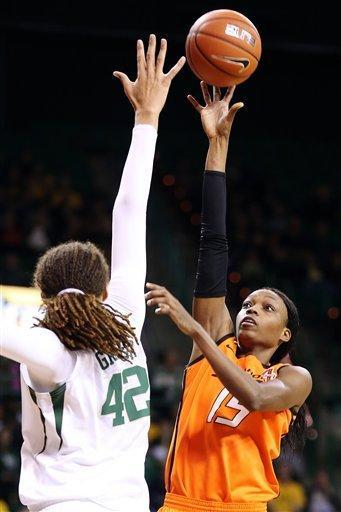 Oklahoma State's Toni Young (15) shoots over Baylor's Brittney Griner (42) during the first half of their NCAA college basketball game, Sunday, Jan. 6, 2013, in Waco, Texas. (AP Photo/The Waco Tribune-Herald, Rod Aydelotte)