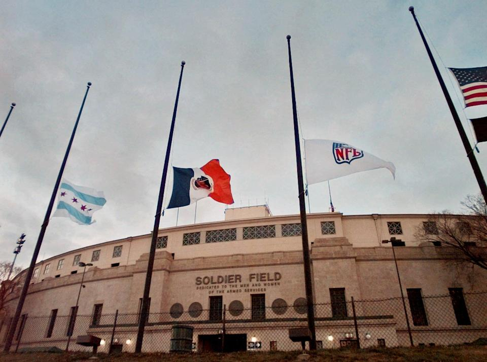 Flags flew at half-staff outside Solider Field following the death of Walter Payton. (AP)