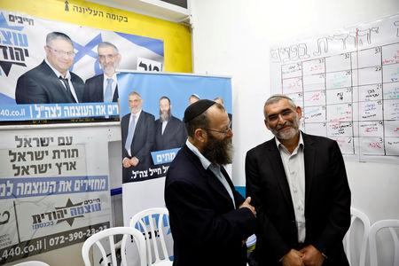 Michael Ben-Ari from the Jewish Power party chats with his party's member Baruch Marzel in Jerusalem, March 17, 2019. REUTERS/Ronen Zvulun