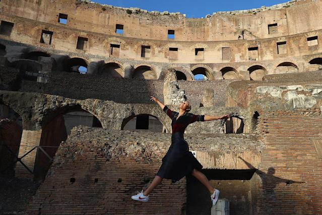 <p>Tennis player Maria Sharapova of Russia jumps in the air to strike a pose inside the Colosseum in Rome, May 14, 2017 (Photo: Michael Steele/Getty Images) </p>