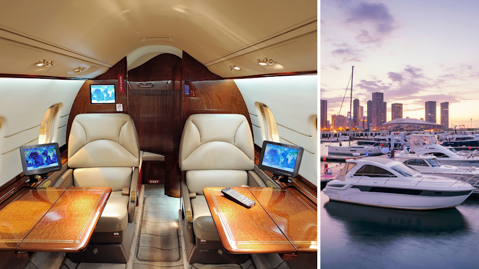 The interior of a private jet and yachts docked at a wharf.
