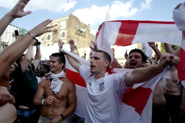 England fans in London celebrate victory against Sweden in the World Cup quarter-finals