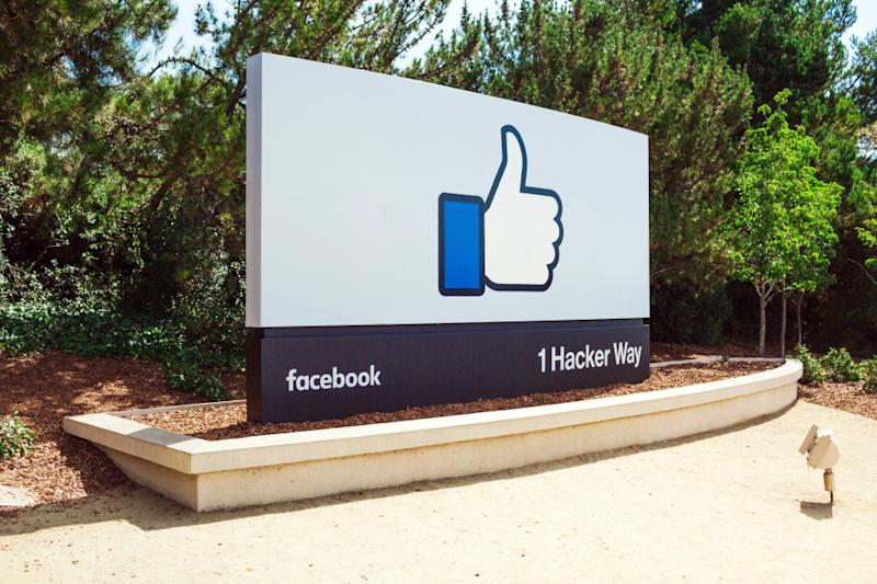 A Facebook thumbs-up emoji on a large sign on the Facebook campus.