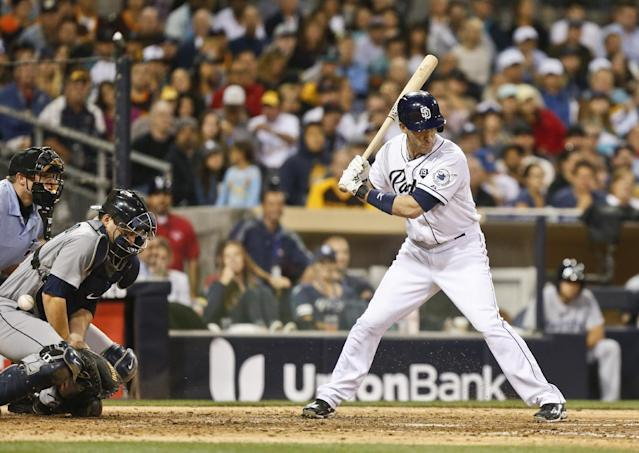 Seattle Mariners catcher Mike Zunino can't handle a wild pitch to San Diego Padres' Chris Denorfia in the sixth inning that allowed the Padres' Alexi Amarista tp score from third and tie the baseball game Wednesday, June 18, 2014, in San Diego. (AP Photo/Lenny Ignelzi)