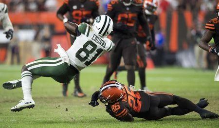 Sep 20, 2018; Cleveland, OH, USA; Cleveland Browns defensive back Derrick Kindred (26) tackles New York Jets wide receiver Quincy Enunwa (81) during the second half at FirstEnergy Stadium. Mandatory Credit: Ken Blaze-USA TODAY Sports