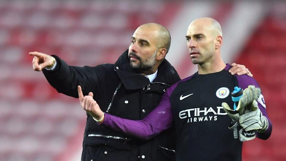 Pep Guardiola e Willy Caballero | Michael Regan/Getty Images