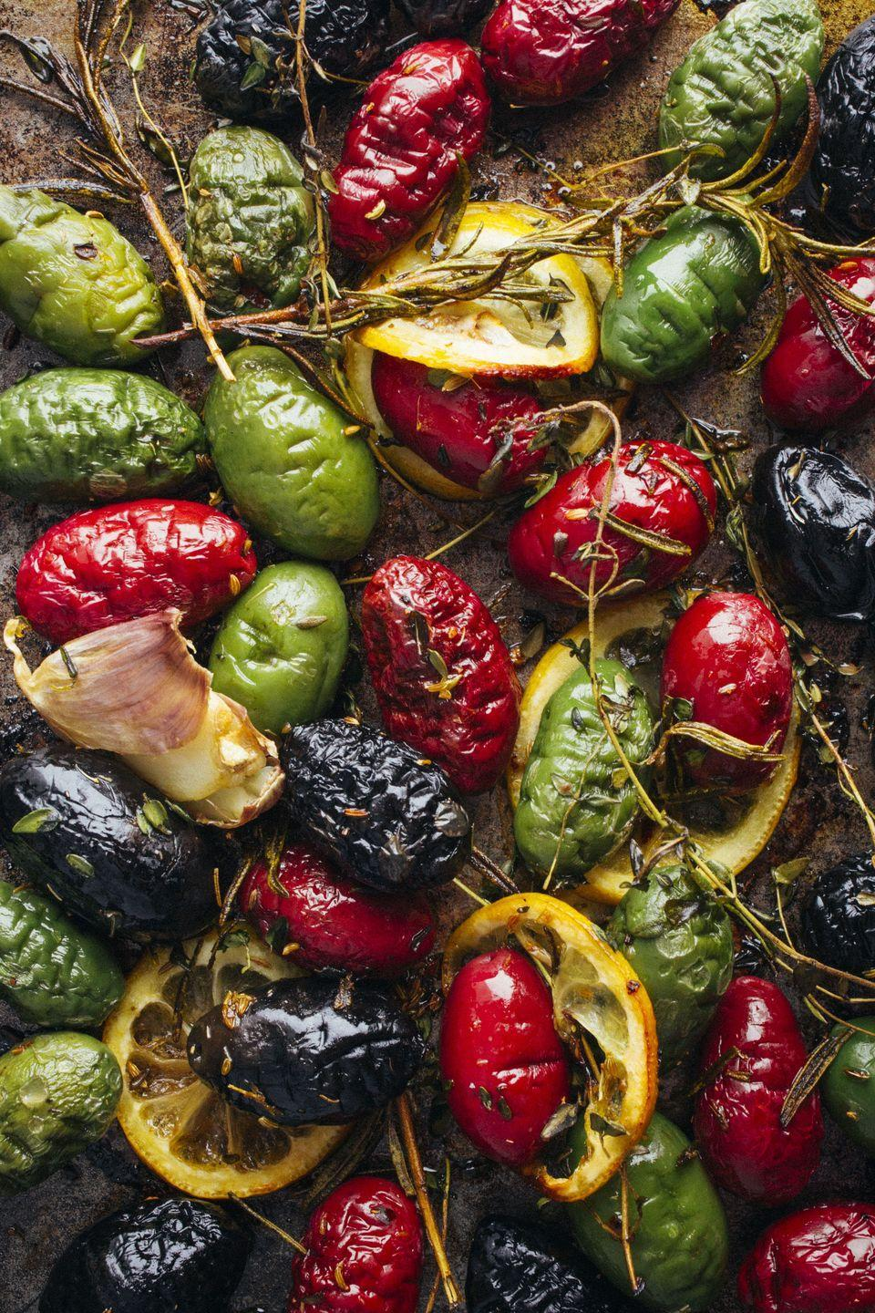 """<p>These roasted olives are basically made for Christmas — look at the colors! </p><p><em><a href=""""https://www.goodhousekeeping.com/food-recipes/easy/a46631/roasted-olives-with-lemon-garlic-and-herbs-recipe/"""" rel=""""nofollow noopener"""" target=""""_blank"""" data-ylk=""""slk:Get the recipe for Roasted Olives with Lemon, Garlic and Herbs »"""" class=""""link rapid-noclick-resp"""">Get the recipe for Roasted Olives with Lemon, Garlic and Herbs »</a></em></p>"""