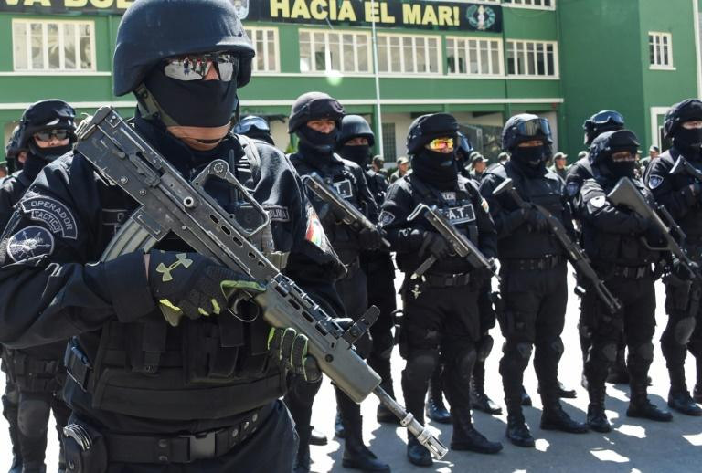 Members of Bolivia's GAT anti-terrorist unit stand guard as they are presented in La Paz, on December 3 (AFP Photo/AIZAR RALDES)