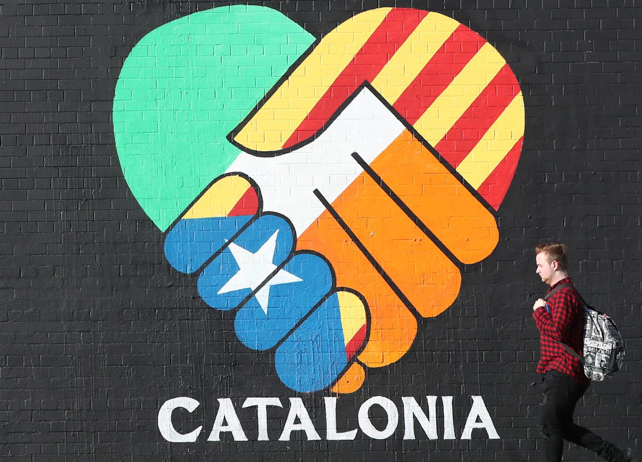 <p>A new pro-Catalan independence muralis painted on Belfast's Falls Road. Spain's Prime Minister has described this month's referendum in Catalonia as part of a strategy 'to impose independence that few want and is good for nobody'. (Niall Carson /PA Wire) </p>