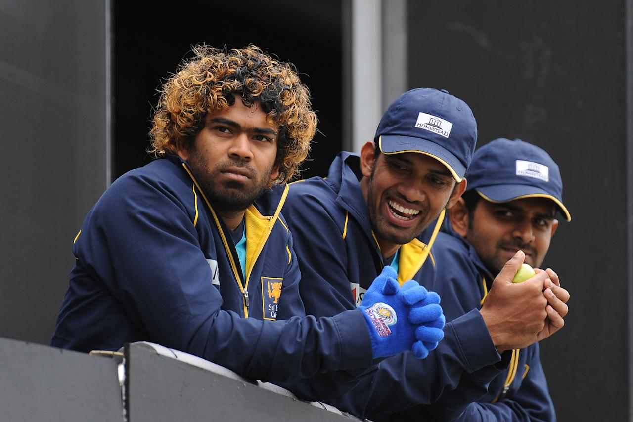 Sri Lanka's Lasith Malinga (left), Sachithra Senanayake (centre) and Lahiru Thirimanne (right) on the balcony before the ICC Champions Trophy Warm Up match at Edgbaston, Birmingham.