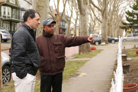 MD Chowdhury stands with Tom Muscarella of the Erie County Health Department and points to improvements made to his lead contaminated home during an interview in Buffalo