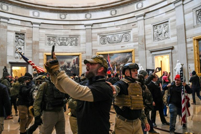 Trump supporters filming themselves in the Capitol Rotunda on January 6, 2021