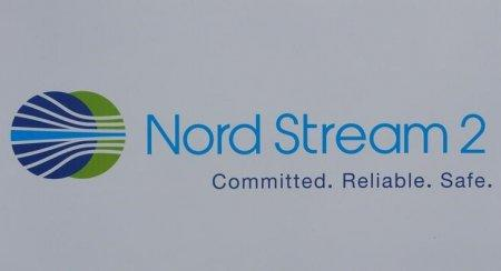 FILE PHOTO: The logo of the Nord Stream-2 gas pipeline project is seen on a board at the St. Petersburg International Economic Forum 2017 (SPIEF 2017) in St. Petersburg, Russia, June 1, 2017. REUTERS/Sergei Karpukhin