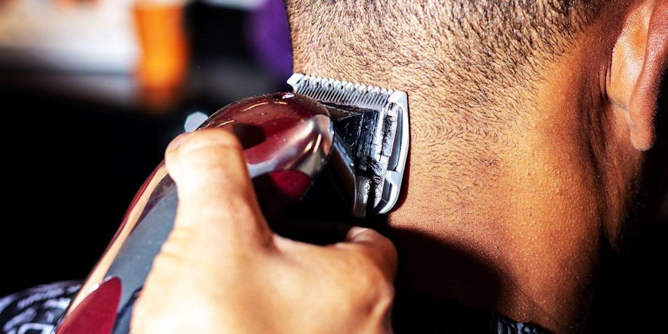 """<p class=""""body-text"""">There are a lot of reasons to see a barber: if you're thinking of changing your hairstyle, if you want a hot towel shave, if you are into especially-complicated haircuts or a simple fade (which is terribly hard if you're trying to do it yourself). But there are some times when you can take matters into your own hands. Keeping your haircut fresh between barber visits is one of them. Going full <em>G.I. Jane</em> and buzzing off your own hair could be one of those, too. We know it can be hard to justify a visit to a barber when you have the type of haircut you might be able to do in our bathroom. If you're going to go that route, <a href=""""https://www.menshealth.com/grooming/a31877251/how-to-cut-your-own-hair-men-tips/"""" rel=""""nofollow noopener"""" target=""""_blank"""" data-ylk=""""slk:there are some things you need to know"""" class=""""link rapid-noclick-resp"""">there are some things you need to know</a>.</p><h2 class=""""body-h2"""">7 Things to Know Before Using Hair Clippers to Cut Your Own Hair</h2><p class=""""body-text"""">1. <a href=""""https://www.menshealth.com/style/a19546134/men-haircuts-should-i-buzz-head/"""" rel=""""nofollow noopener"""" target=""""_blank"""" data-ylk=""""slk:Decide on what style you want"""" class=""""link rapid-noclick-resp"""">Decide on what style you want</a>. Buzz cuts are a general style and have a ton of variations, so before firing up the clippers, consider the final outcome you're hoping for.<br><br>2. Buy a hand mirror or create a dual-mirror setup. This is especially important if <a href=""""https://www.menshealth.com/grooming/a31877251/how-to-cut-your-own-hair-men-tips/"""" rel=""""nofollow noopener"""" target=""""_blank"""" data-ylk=""""slk:you're doing this on your own"""" class=""""link rapid-noclick-resp"""">you're doing this on your own</a> because you'll need to be able to see the back of your head.<br><br>3. Use your bathroom as a barber shop. Make sure it's well-lit and you're comfortable in front of the mirror. Go shirtless (or nude, <a href=""""https://www.menshealth.com/grooming/a31877251"""
