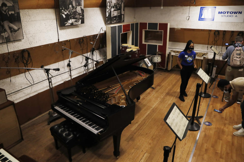 Motown Museum tour guide Jamia Henry talks about Studio A in the museum, Wednesday, July 15, 2020, in Detroit. The Detroit building where Berry Gordy Jr. built his music empire reopened its doors to the public on Wednesday. It had been closed since March due to the coronavirus pandemic. (AP Photo/Carlos Osorio)