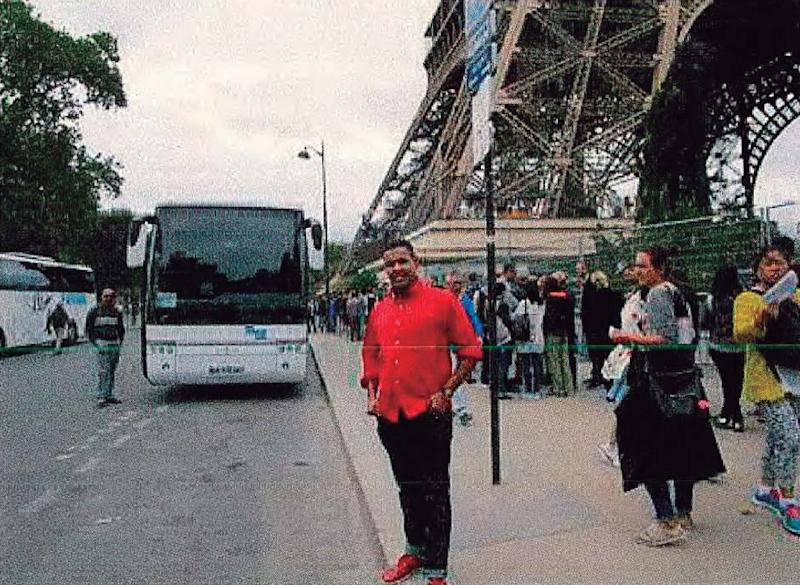 An alleged member of the Islamist cell suspected of carrying out last year's jihadists attacks in Catalonia poses next to the Eiffel Tower