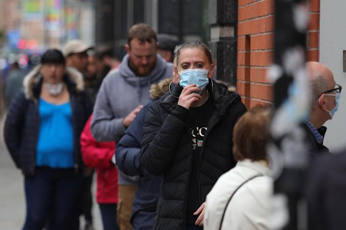 A member of the public wearing a face mask in Manchester, as new figures showed the number of coronavirus deaths is at the lowest level since March. (PA)
