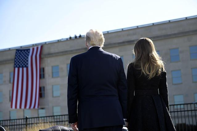 <p>President Trump and first lady Melania Trump attend a ceremony at the Pentagon's 9/11 Memorial in Washington, D.C., on Sept. 11, 2017, on the 16th anniversary of 9/11. (Photo: Brendan Smialowski/AFP/Getty Images) </p>