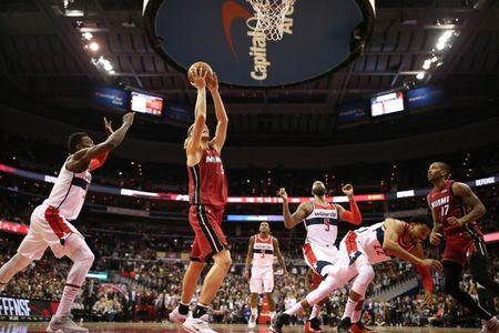 Oct 18, 2018; Washington, DC, USA; Miami Heat forward Kelly Olynyk (9) makes the game-winning basket in front of Washington Wizards forward Jeff Green (32) in the final second of the fourth quarter at Capital One Arena. Mandatory Credit: Geoff Burke-USA TODAY Sports