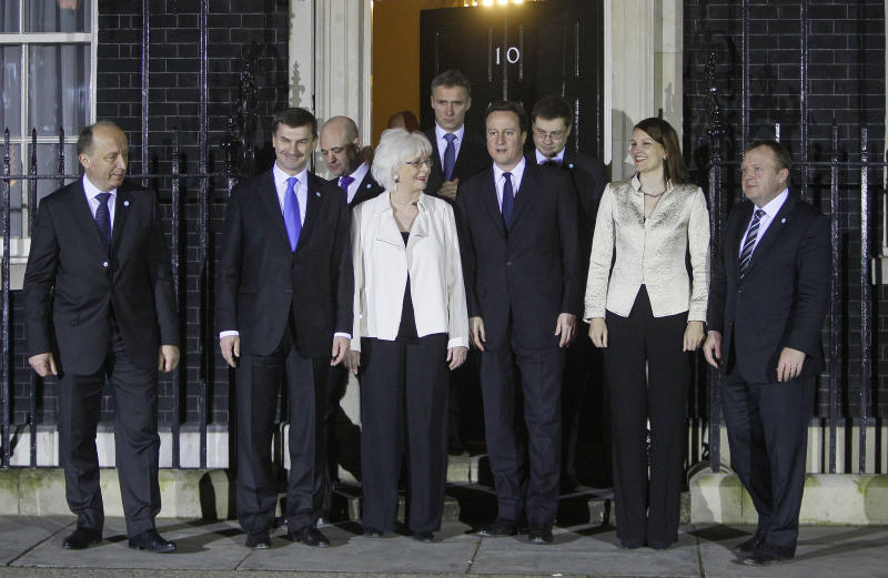 Prime Ministers from the Nordic and Baltic region along with the British Prime Minister David Cameron pose for a group photo on the doorstep of 10 Downing Street, in London, Wednesday, Jan., 19  2011. They are from the left- Lithuania -Adrius Kubilius, Estonia -Andrus Ansip, Sweden part hidden- Fredrik Reinfeldt,  Iceland -Johanna Sigurdardottir, Norway-Jens Stoltenberg, Britain- David Cameron, Latvia-Valdis Dombrovskis, Finalnd-Mari Kiviniemi, and Denmark- Lars Lokke Rasmussen. (AP Photo/Alastair Grant)