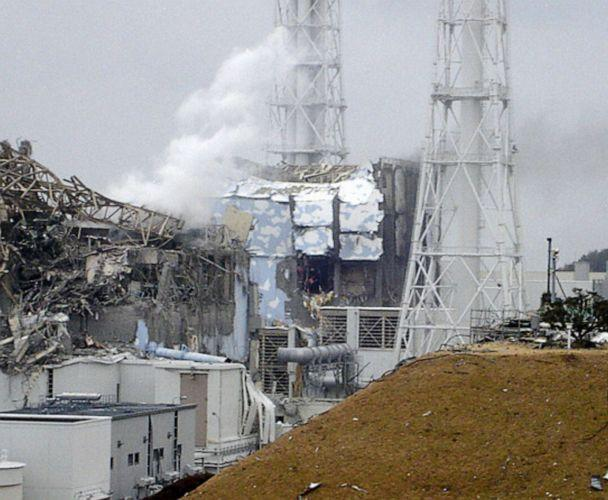 PHOTO: This handout photo shows the smoking No.3 reactor building (L) and the damaged No. 4 reactor building (C) of the quake-hit Fukushima Daiichi Nuclear Power Station on March 15, 2011, in Fukushima Prefecture, Okuma, Japan. (Kyodo News Stills via Getty Images)