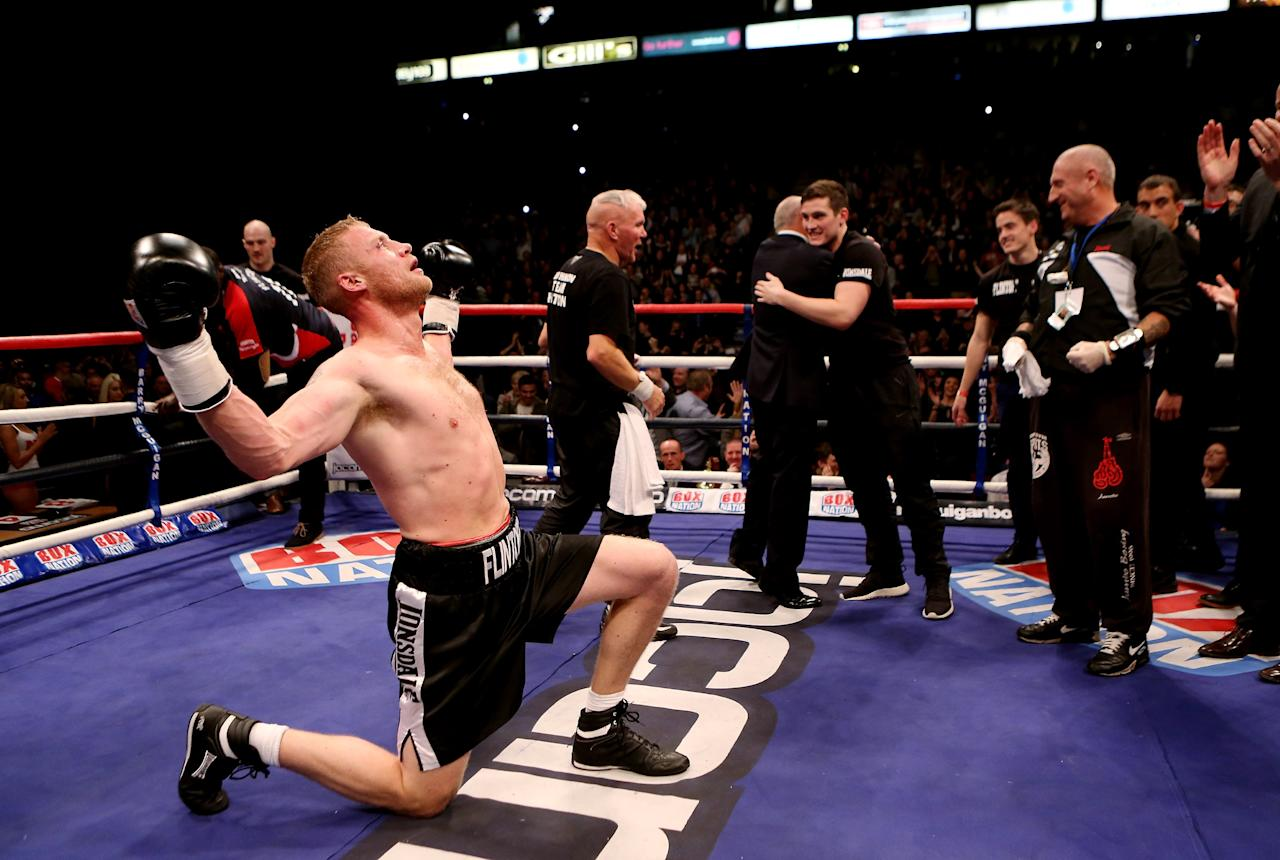 MANCHESTER, ENGLAND - NOVEMBER 30:  Andrew Flintoff celebrates after victory in his International Heavyweight bout with Richard Dawson at MEN Arena on November 30, 2012 in Manchester, England.  (Photo by Scott Heavey/Getty Images)