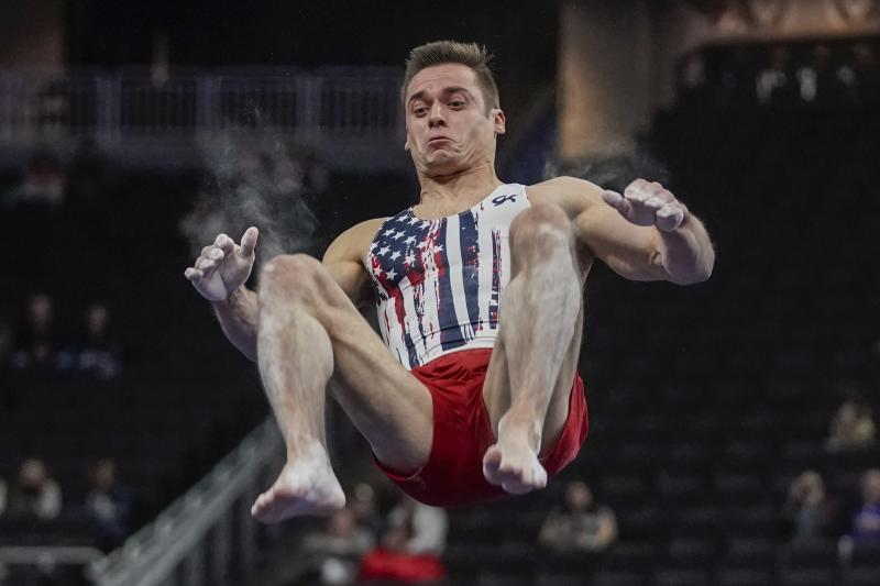 Sam Mikulak of the United States performs on the floor during the American Cup gymnastics competition Saturday, March 7, 2020, in Milwaukee. (AP Photo/Morry Gash)