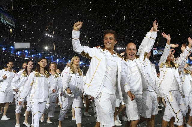 Britain's Tom Daley, center, parades with fellow athletes during the Opening Ceremony at the 2012 Summer Olympics, Friday, July 27, 2012, in London. (AP Photo/Cameron Spencer, Pool)