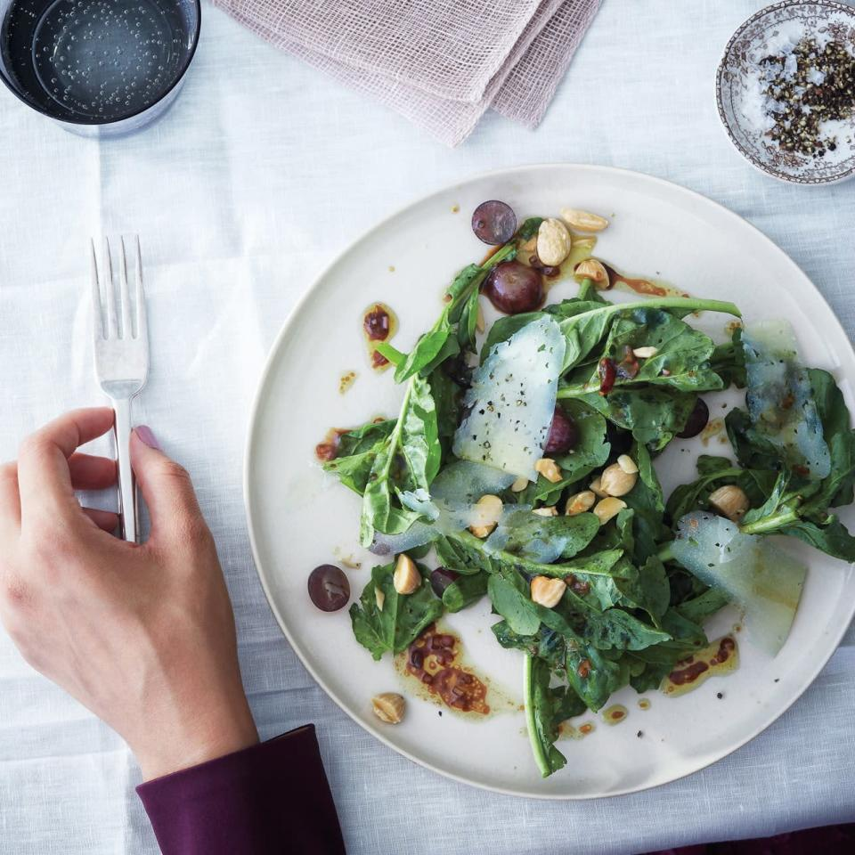 """Grapes appear here in three forms: crushed and whisked into the vinaigrette, halved and tossed with arugula, and aged in saba, a balsamic-like syrup made from grape must. <a href=""""https://www.epicurious.com/recipes/food/views/arugula-grape-and-almond-salad-with-saba-vinaigrette-51123120?mbid=synd_yahoo_rss"""" rel=""""nofollow noopener"""" target=""""_blank"""" data-ylk=""""slk:See recipe."""" class=""""link rapid-noclick-resp"""">See recipe.</a>"""