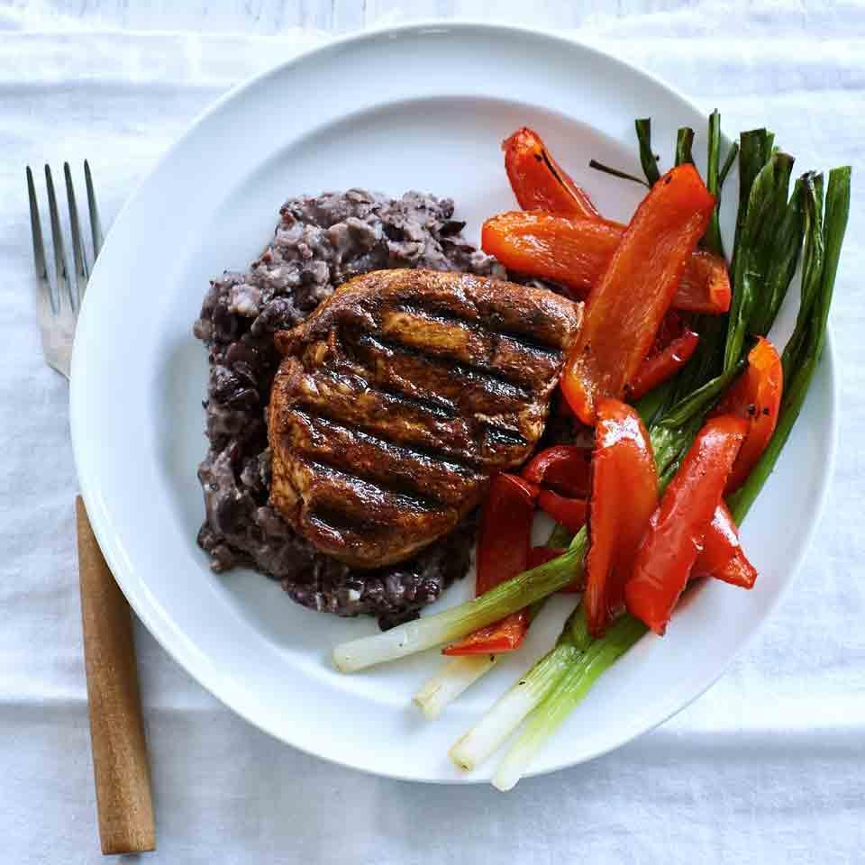 <p>In this healthy chicken recipe, the meat is rubbed with ancho chile powder, a spice made from dried poblano peppers. It adds mild heat and subtle smokiness to the rub on the chicken, but you can use regular chili powder here instead. This recipe makes an extra 1/2 cup of the black bean mash--try it wrapped into a burrito for lunch or as a taco filling (see Tips, below).</p>