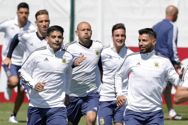 From right to left, Sergio Aguero, Nicolas Tagliafico, Javier Mascherano and Ever Banega jog during a training session of Argentina on the eve of their group D match against Iceland at the 2018 soccer World Cup in Bronnitsy, Russia, Friday, June 15, 2018. (AP Photo/Ricardo Mazalan)