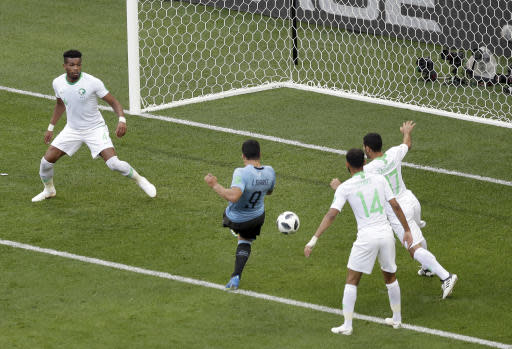 Uruguay's Luis Suarez, center, scores the opening goal during the group A match between Uruguay and Saudi Arabia at the 2018 soccer World Cup in Rostov Arena in Rostov-on-Don, Russia, Wednesday, June 20, 2018. (AP Photo/Themba Hadebe)