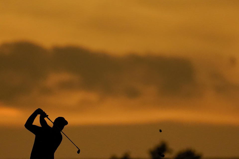Jon Rahm, of Spain, hits from the 16th fairway during the second round of the BMW Championship golf tournament, Friday, Aug. 27, 2021, at Caves Valley Golf Club in Owings Mills, Md. (AP Photo/Julio Cortez)