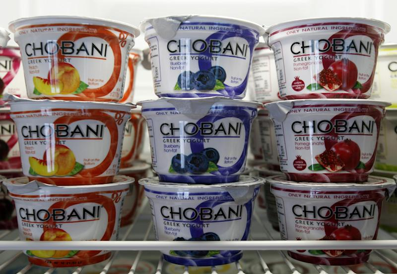 FILE - This Jan. 13, 2012 file photo shows cups of Chobani Yogurt at Chobani Greek Yogurt in South Edmeston, N.Y. Team USA sponsor Chobani, which is based in upstate New York, says it has 5,000 cups of Greek yogurt sitting in a refrigerated warehouse waiting to be flown to the Olympic village. But Russian authorities say the U.S. Department of Agriculture has refused to provide a certificate that is required for dairy products under its customs rules. A U.S. Department of Agriculture spokeswoman says the agency is working with its Russian counterpart to reach a solution to allow the Chobani shipment to go through despite the lack of agreement on general trade requirements for dairy products.(AP Photo/Mike Groll, File)