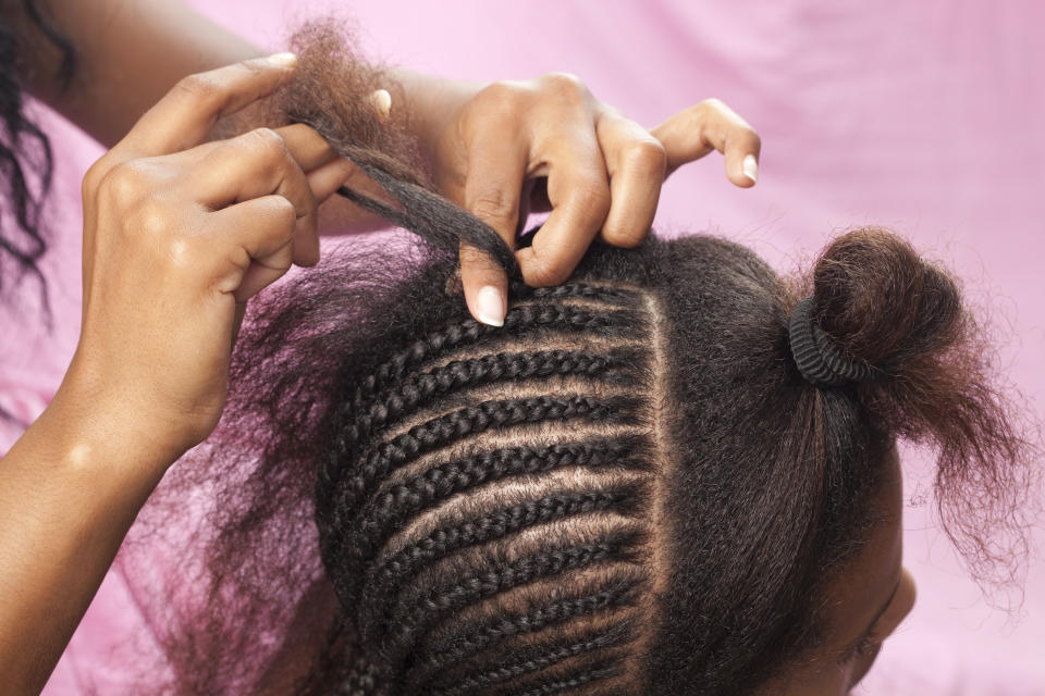 Getting your hair braided could take an entire day, so the experience became a social event for many women in the Black community. (Stock photo/Getty Images)