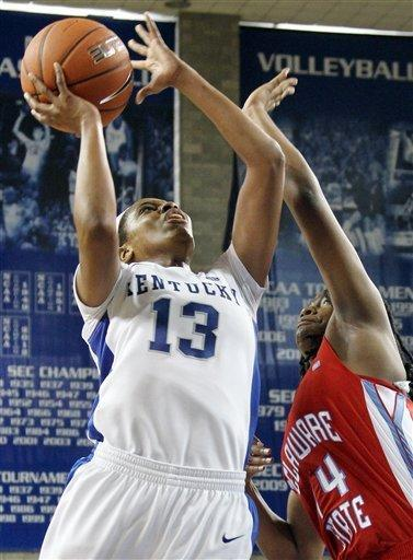 Kentucky's Bria Goss (13) shoots next to Delaware State's Keyanna Tate during the second half of an NCAA college basketball game at Memorial Coliseum in Lexington, Ky., Saturday, Nov. 10, 2012. Kentucky won 90-50. (AP Photo/James Crisp)