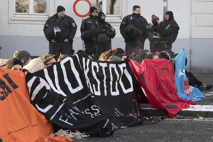 Demonstrators block the street to a hotel where a meeting of European nationalists is planned in Koblenz, Germany, Saturday, Jan. 21, 2017. Dutch populist anti-Islam lawmaker Geert Wilders, AfD (Alternative for Germany) chairwoman Frauke Petry, far-right leader and candidate for next spring presidential elections Marine le Pen from France and Italian Lega Nord chief Matteo Salvini will attend the meeting. (Boris Roessler/dpa via AP)