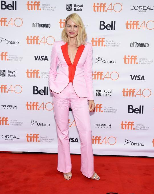 "<p>Naomi Watts, who plays Elle Fanning's mother in ""About Ray,"" switched things up and traded her fun and frilly dresses for a suit. But just because she's in pants doesn't make her outfit unexciting! The actress opted for a pink ensemble, made even more exuberant with bright red lapels on the blazer.</p>"