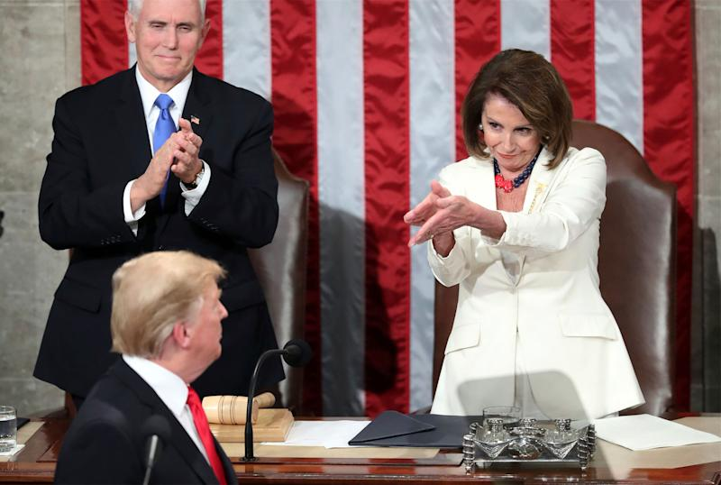 President Donald Trump turns to House speaker Nancy Pelosi of Calif., as he delivers his State of the Union address to a joint session of Congress on Capitol Hill in Washington, as Vice President Mike Pence watches, Tuesday, Feb. 5, 2019. (AP Photo/Andrew Harnik)