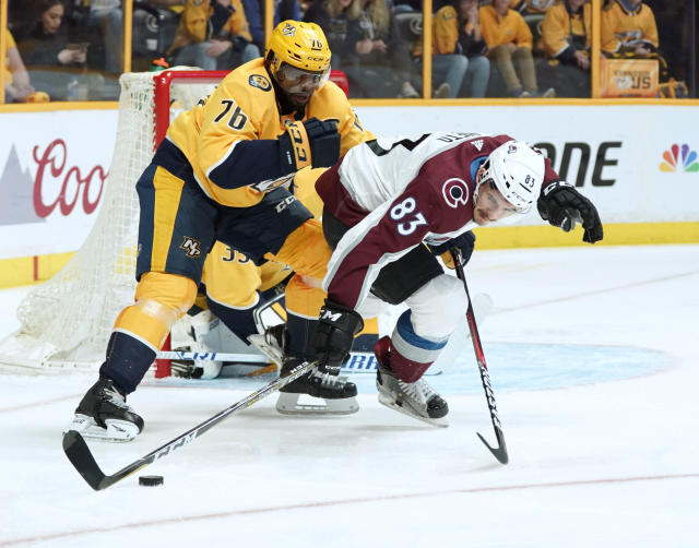 Nashville Predators defenseman P.K. Subban (76) knocks Colorado Avalanche left wing Matt Nieto (83) off the puck during the first period in Game 5 of an NHL hockey first-round playoff series Friday, April 20, 2018, in Nashville, Tenn. (AP Photo/Sanford Myers)