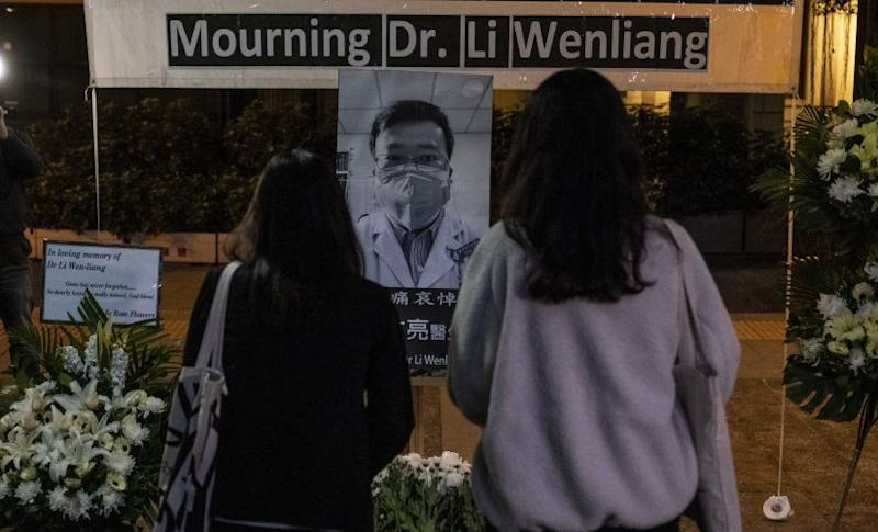 People pay respects at a memorial to Li Wenliang, who was silenced by the police for being one of the first to warn about the coronavirus, in Hong Kong. Lam Yik Fei © 2020 The New York Times