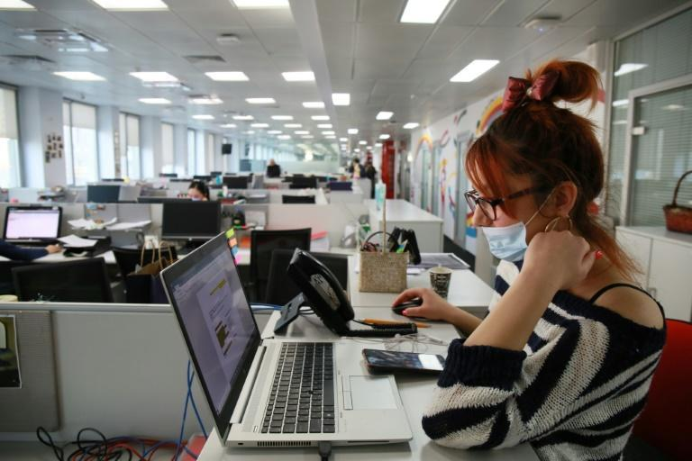 An employee of Kaspi, Kazakhstan's payment systems and e-commerce leader, at the London-listed company's HQ in the capital Almaty