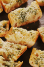 """<p>The secret to really good garlic bread is to keep it simple. And to use a lot of garlic—4 cloves for one loaf!</p><p>Get the <a href=""""https://www.delish.com/uk/cooking/recipes/a30255379/easy-garlic-bread-recipe/"""" rel=""""nofollow noopener"""" target=""""_blank"""" data-ylk=""""slk:Classic Garlic Bread"""" class=""""link rapid-noclick-resp"""">Classic Garlic Bread</a> recipe.</p>"""