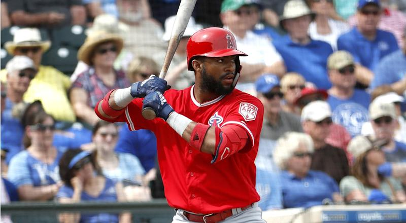 Angels' Jo Adell hits against the Kansas City Royals during the second inning of a spring training game in Surprise, Ariz.