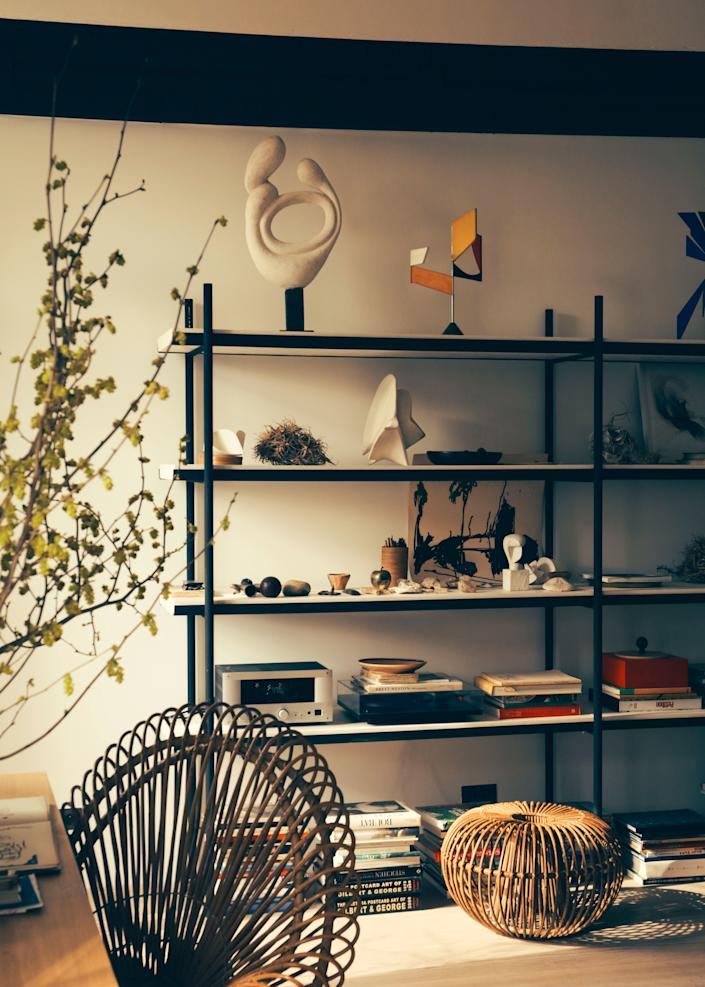 """<div class=""""caption""""> Shelving designed by Champsaur displays his various collections. </div>"""