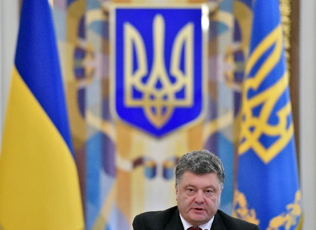 Ukrainian President Petro Poroshenko speaks during the opening of the extraordinary sitting of the National Security and Defence Council in Kiev on August 28, 2014